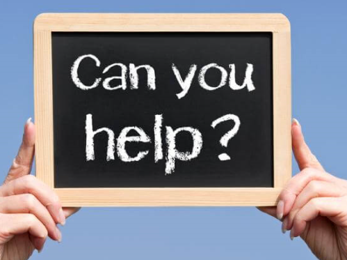 Image of blackboard, reading 'can you help?'