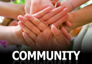 Photo of hands together, text reading 'Community'
