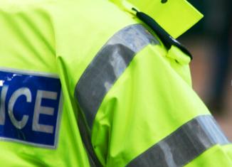 Image of back of Police Uniform