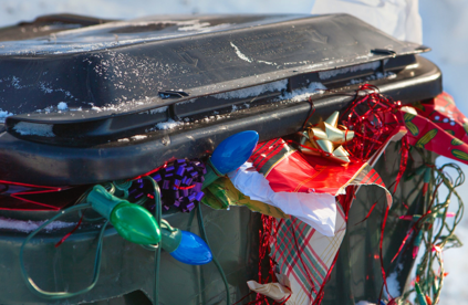 Rubbish Bin full of Christmas wrapping paper