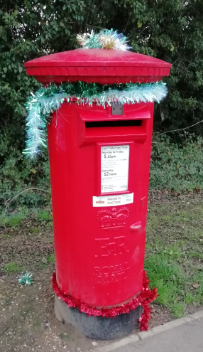 Image of a Letterbox with tinsel